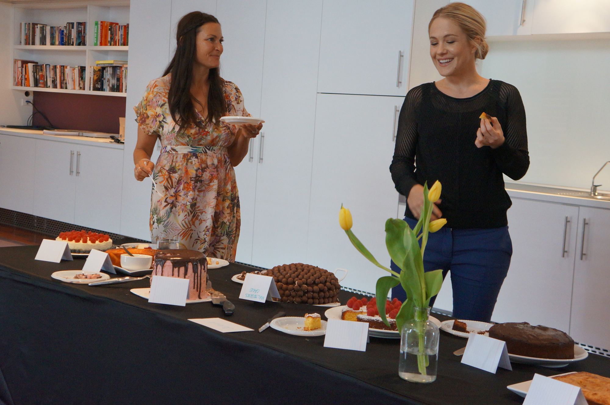 Cake tasting, serious business! Lee Holmes & Kate Gibbs get stuck in.