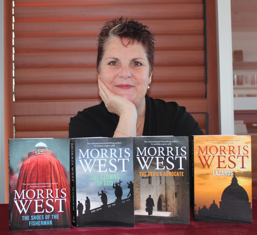 Morris West's daughter Melanie Bryan with some of her father's books
